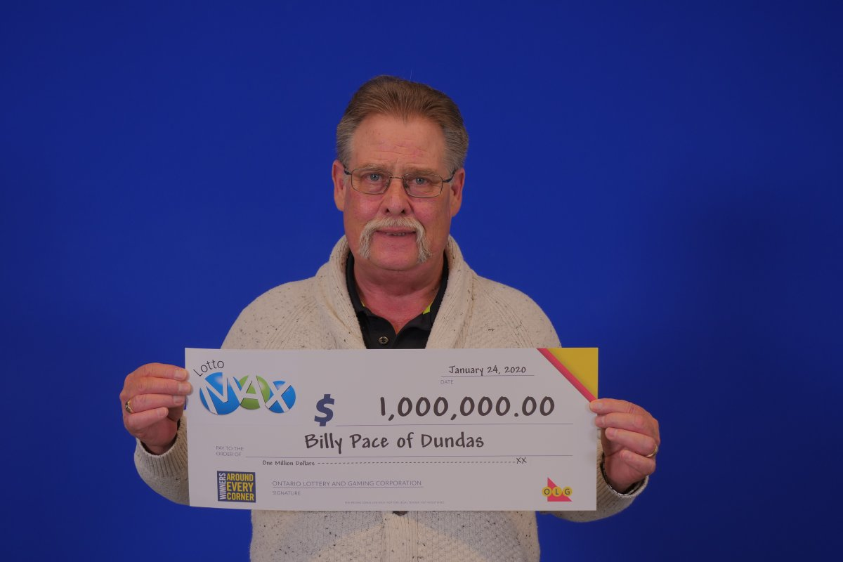 Billy Pace of Dundas showcases his $1,000,000 cheque after winning the Dec. 31, 2019 MAXMILLIONS prize.
