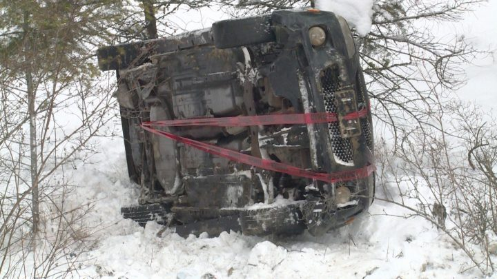 The sedan rolled down the embankment, coming to a stop around 40 feet from the road.
