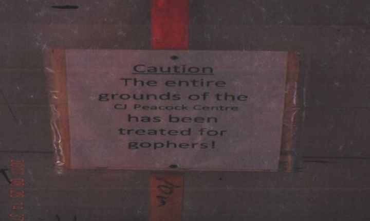 A photo of a sign that was posted at the CJ Peacock Centre in Cereal, Alta., after strychnine was applied in the area.