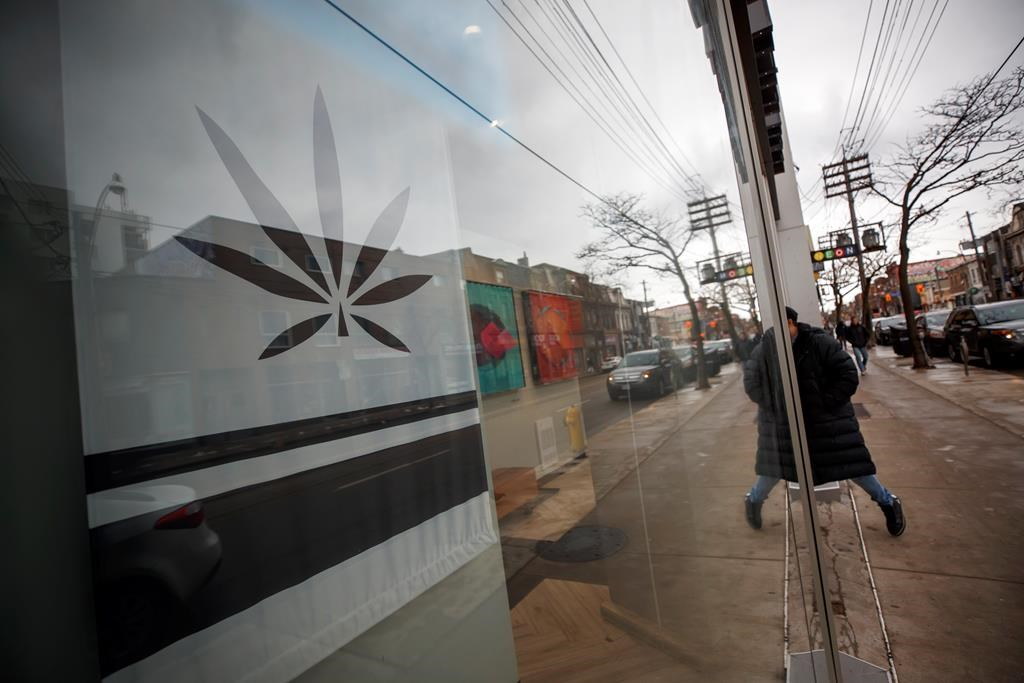 A customer walks into a Cannabis dispensary on Queen St. in Toronto, Monday, Jan. 6, 2020. THE CANADIAN PRESS/Cole Burston.