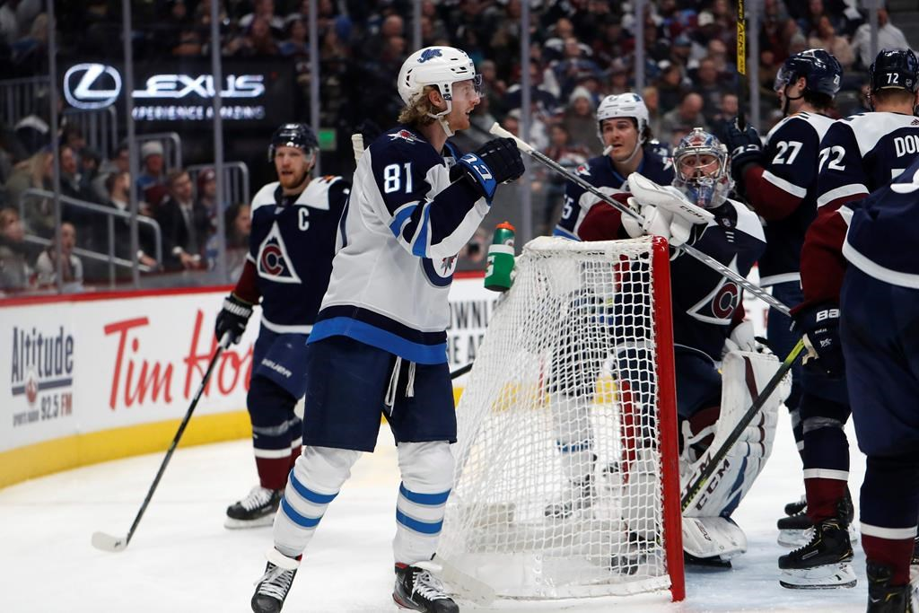 Winnipeg Jets left wing Kyle Connor reacts after scoring a goal against the Colorado Avalanche during the second period of an NHL hockey game Tuesday, Dec. 31, 2019, in Denver.