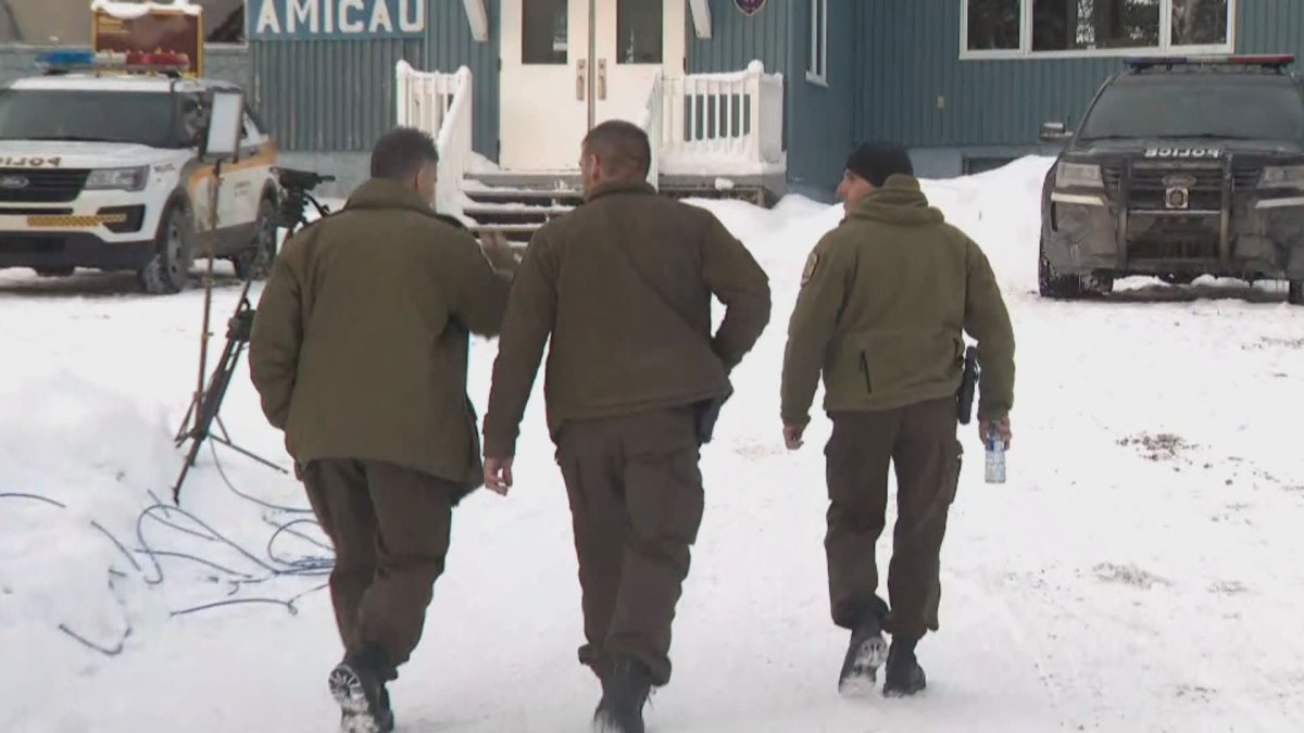Quebec provincial police canvass the area where five French tourists remain missing.