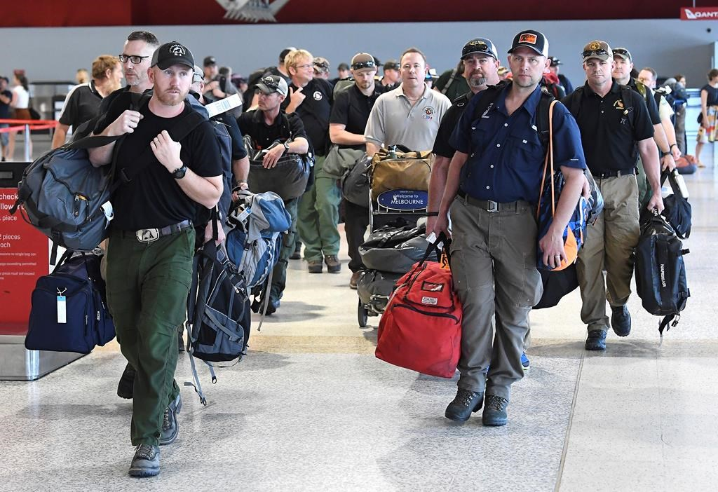A contingent of 39 firefighters from the United States and Canada arrive at Melbourne Airport in Melbourne, Thursday, January 2, 2020. Another 69 Canadians are heading to Australia this week to help fight the country's worst bushfires in recent memory. Foreign Affairs Minister Francois-Philippe Champagne says on Twitter the deployment comes after Australia requested more help.