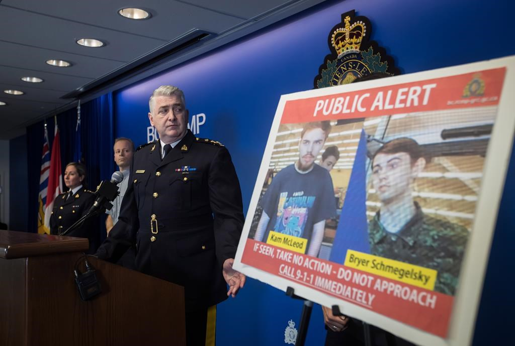 Security camera images recorded in Saskatchewan of Kam McLeod, 19, and Bryer Schmegelsky, 18, are displayed as RCMP Assistant Commissioner Kevin Hackett steps away from the podium after speaking during a news conference in Surrey, B.C., on Tuesday July 23, 2019.