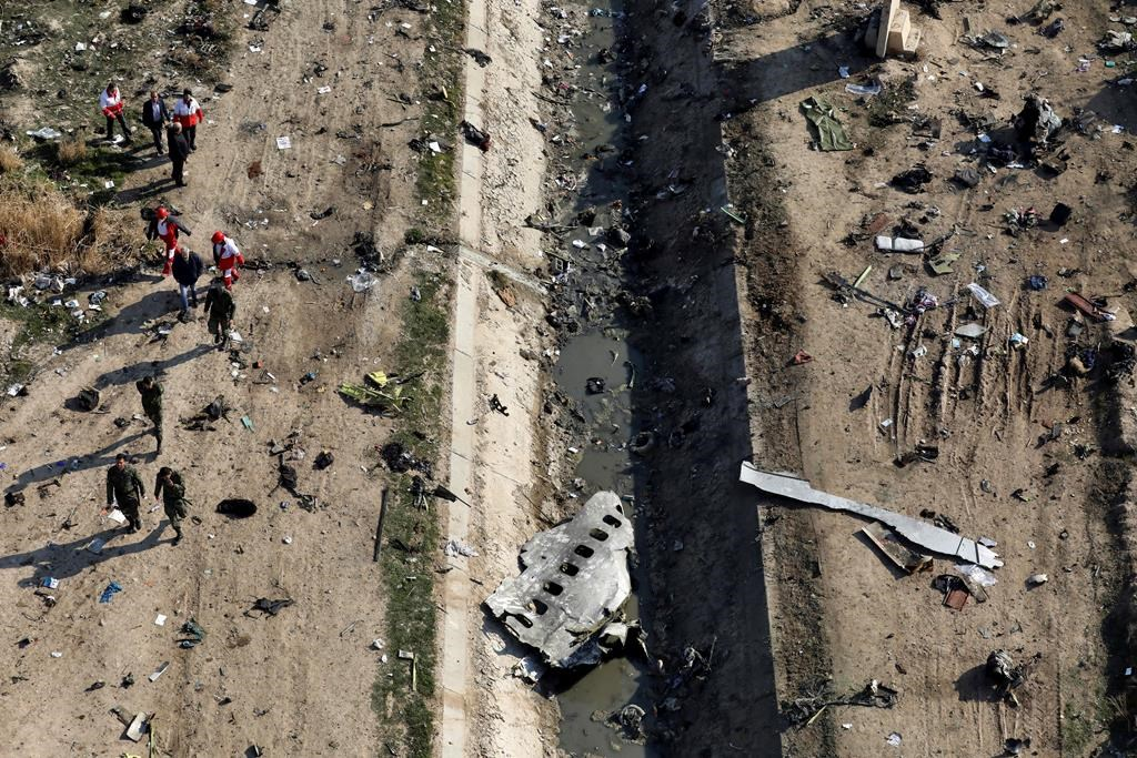 In this Wednesday, Jan. 8, 2020 photo, rescue workers search the scene where a Ukrainian plane crashed in Shahedshahr, southwest of the capital Tehran, Iran. THE CANADIAN PRESS/AP-Ebrahim Noroozi.