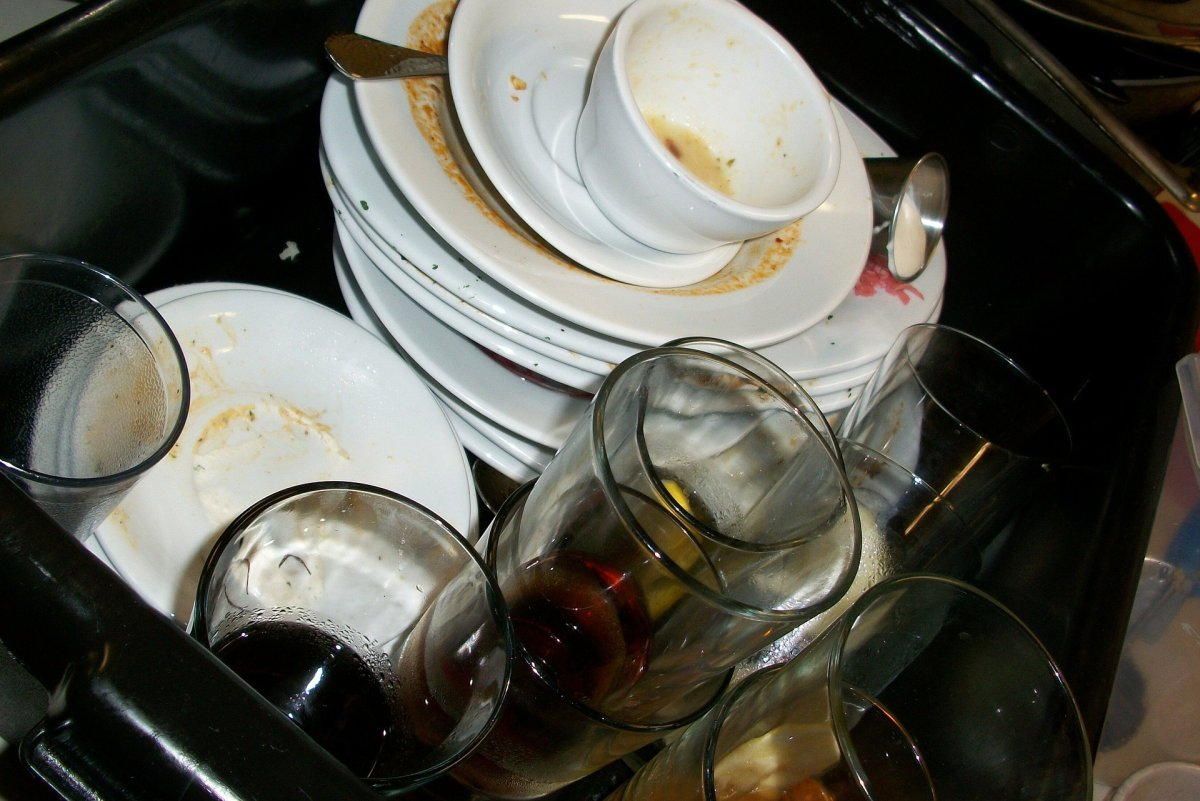 A pile of dirty dishes in a sink.