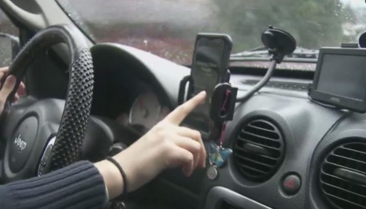 Police say multiple touches on a mounted cellphone or handheld device while driving is illegal under Manitoba's distracted driving laws.
