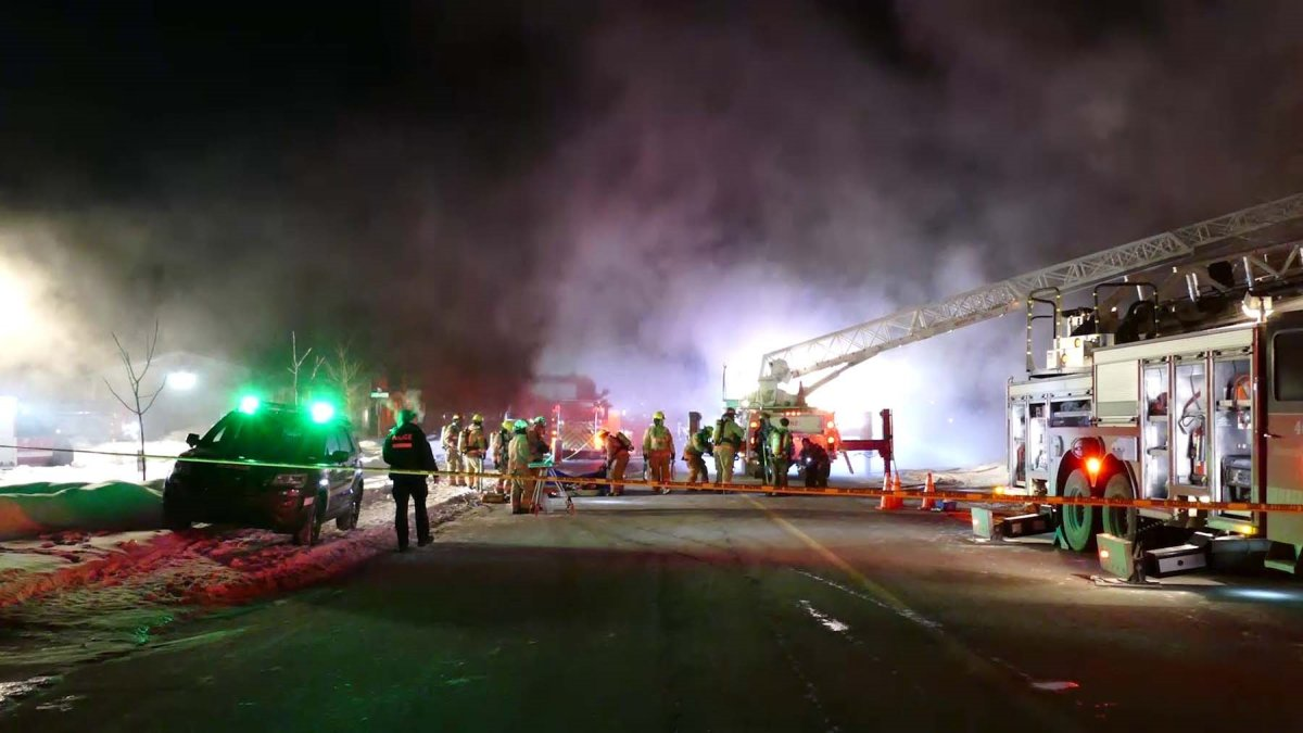 Montreal firefighters attempting to extinguish the blaze at a home on  Westpark bvld. in Pierrefonds.