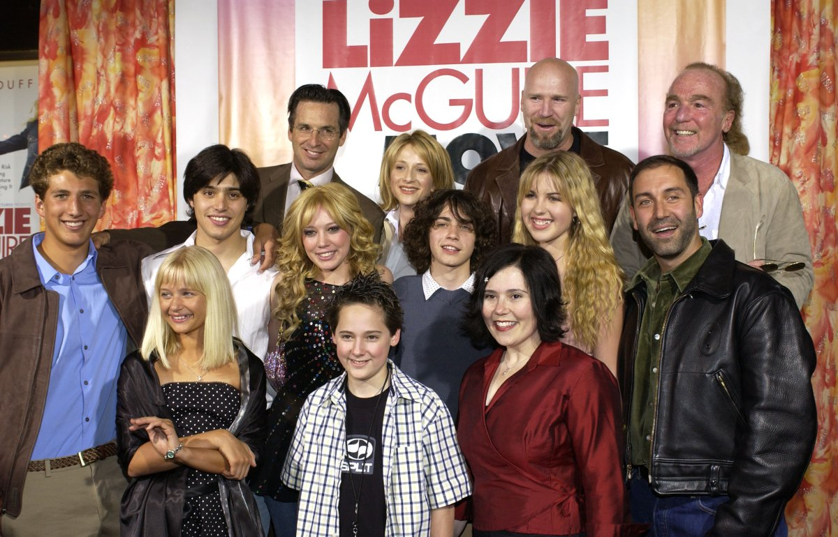 'The Lizzie McGuire Movie' cast with producer Stan Rogow (top far right) and Jim Fall, director (middle far right) .