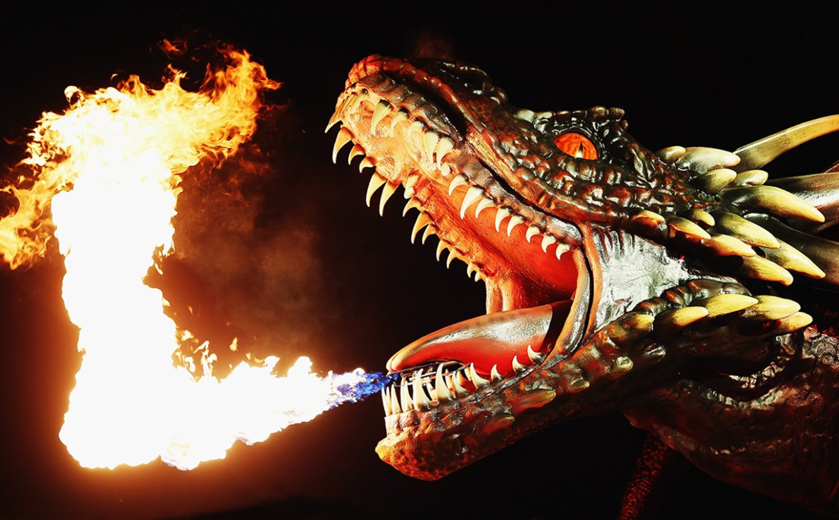 A dragon statue emits fire as people look on during the Sydney premiere of 'Game Of Thrones' at Sydney Opera House on April 13, 2015 in Sydney, Australia.