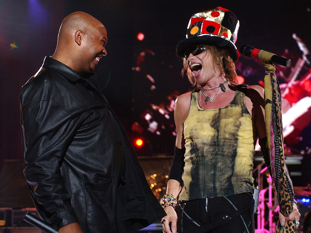 """(L-R) Darryl """"D.M.C."""" McDaniels of Run D.M.C. and Steven Tyler of Aerosmith performing live in concert."""
