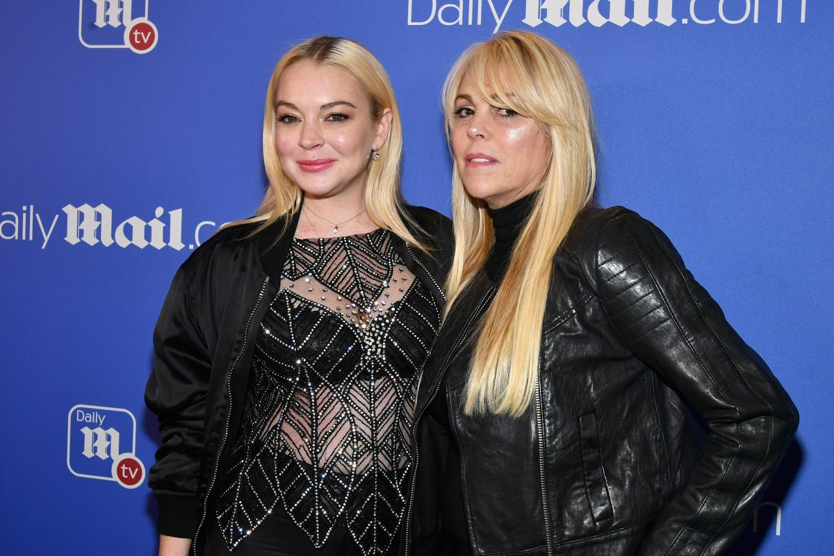 Lindsay Lohan (L) and Dina Lohan attend the DailyMail.com & DailyMailTV holiday party with Flo Rida on Dec. 6, 2017 at The Magic Hour in New York City.