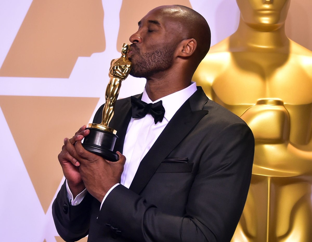 Kobe Bryant poses in the press room with the Oscar for Best Animated Short Film for 'Dear Basketball' during the 90th Annual Academy Awards on March 4, 2018, in Hollywood, Calif.