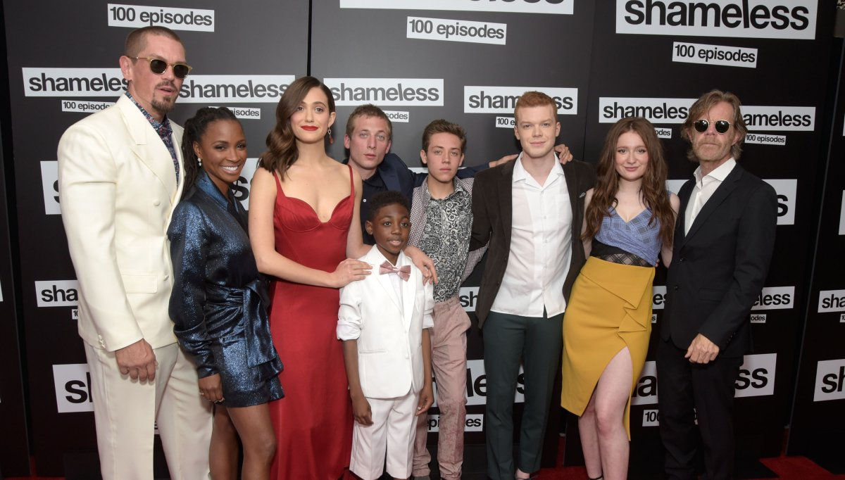 """(L - R) Steve Howey, Shanola Hampton, Emmy Rossum, Jeremy Allen White, Christian Isaiah, Ethan Cutkowsky, Cameron Monaghan, Emma Kenney and William H. Macy attend the celebration of the 100th episode of Showtime's """"Shameless"""" at DREAM Hollywood on June 9, 2018 in Hollywood, California."""