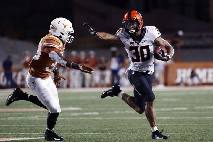 In this Sept. 21, 2019, file photo,Oklahoma State running back Chuba Hubbard (30) runs against Texas defensive back Montrell Estell (39) during the second half of an NCAA college football game, in Austin, Texas.
