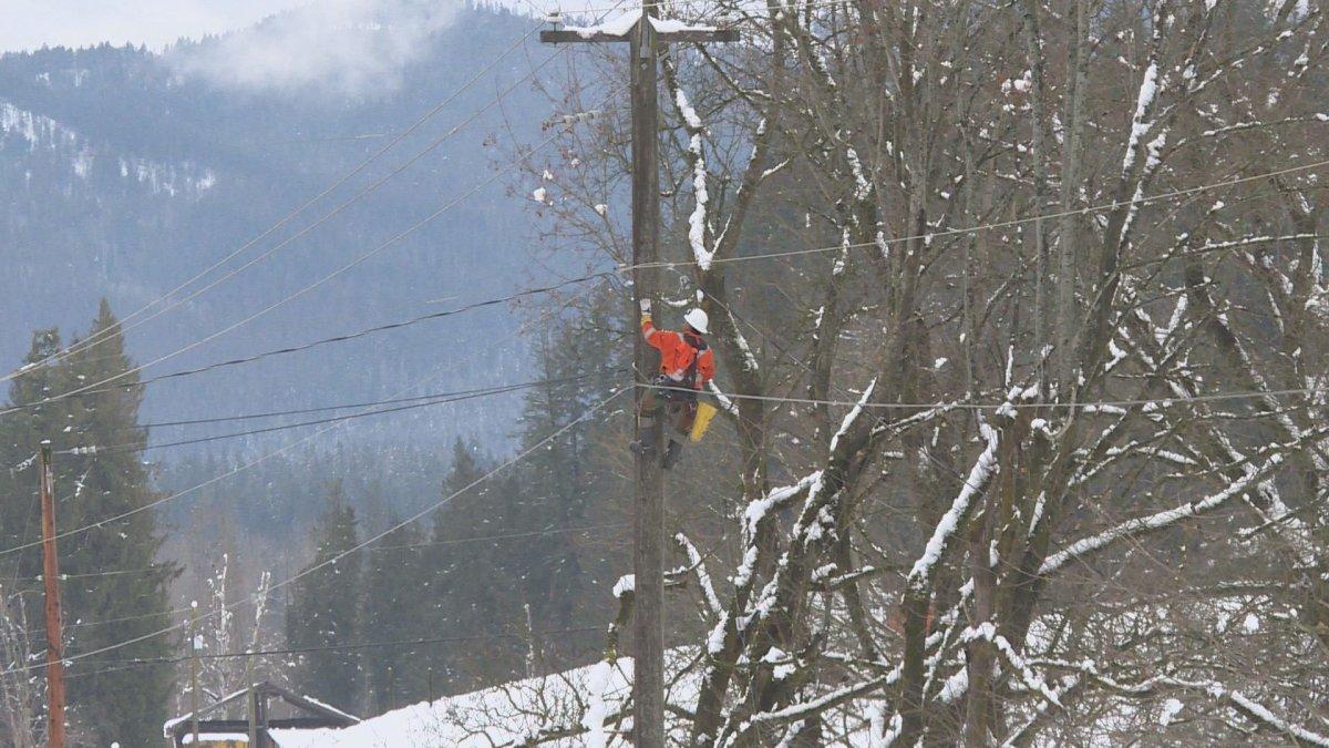 A BC Hydro crew member works on a power pole on Thursday, Jan. 2, 2020 near Salmon Arm.