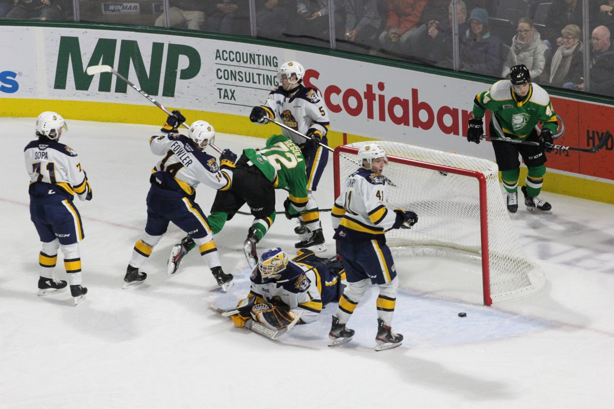 London Knights defenceman Alec Regula gets knocked to the ice after scoring what would end up as the game-winning goal in a 6-2 London victory over the Erie Otters on Jan. 19, 2020.