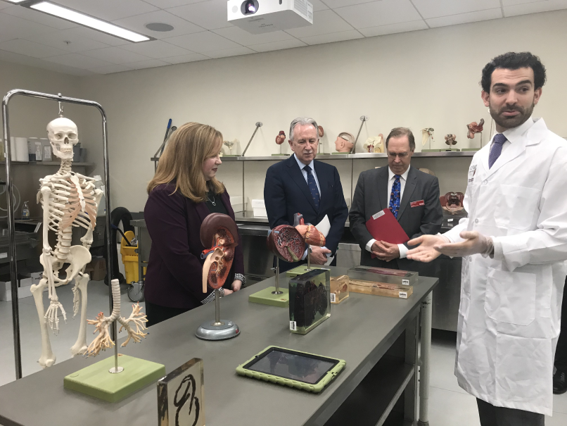 Representatives from McMaster and Brock tour the anatomy lab at the Roy and Lois Cairns Health and Bioscience Research Complex after signing a five-year extension of the two universities' collaboration.