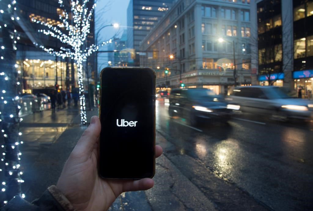 The Uber App is pictured on a smartphone in downtown Vancouver, B.C., Monday, December 30, 2019. British Columbia's Passenger Transportation Board has granted long-awaited licensing approvals to ride-hailing companies Uber and Lyft for service in the Lower Mainland and Whistler. THE CANADIAN PRESS/Jonathan Hayward.