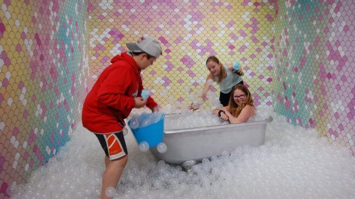 Kids enjoy the bathtub and bubbles experience at the Saskatchewan Science Centre's JoyLab.