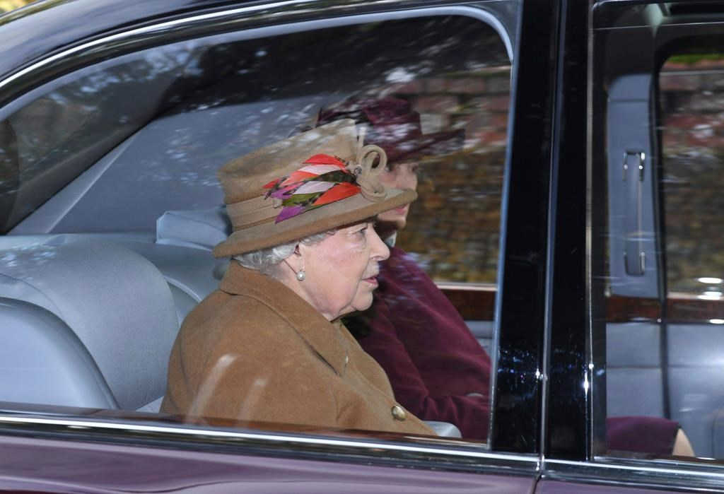 Britain's Queen Elizabeth II arrives to attend a morning church service at St. Mary Magdalene Church in Sandringham, England, Sunday Jan. 12, 2020.