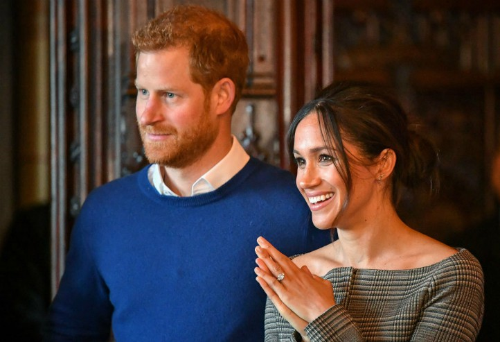 Prince Harry and Meghan Markle watch a performance by a Welsh choir in the banqueting hall during a visit to Cardiff Castle. PRESS ASSOCIATION Photo. Picture date: Thursday January 18, 2018. Ben Birchall/PA Wire.