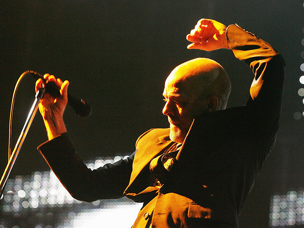 REM and Michael Stipe perform on stage in England.