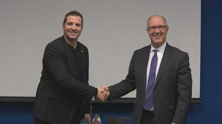 Outgoing MJHL commissioner Kim Davis (right) welcomes new commissioner Kevin Saurette (left).