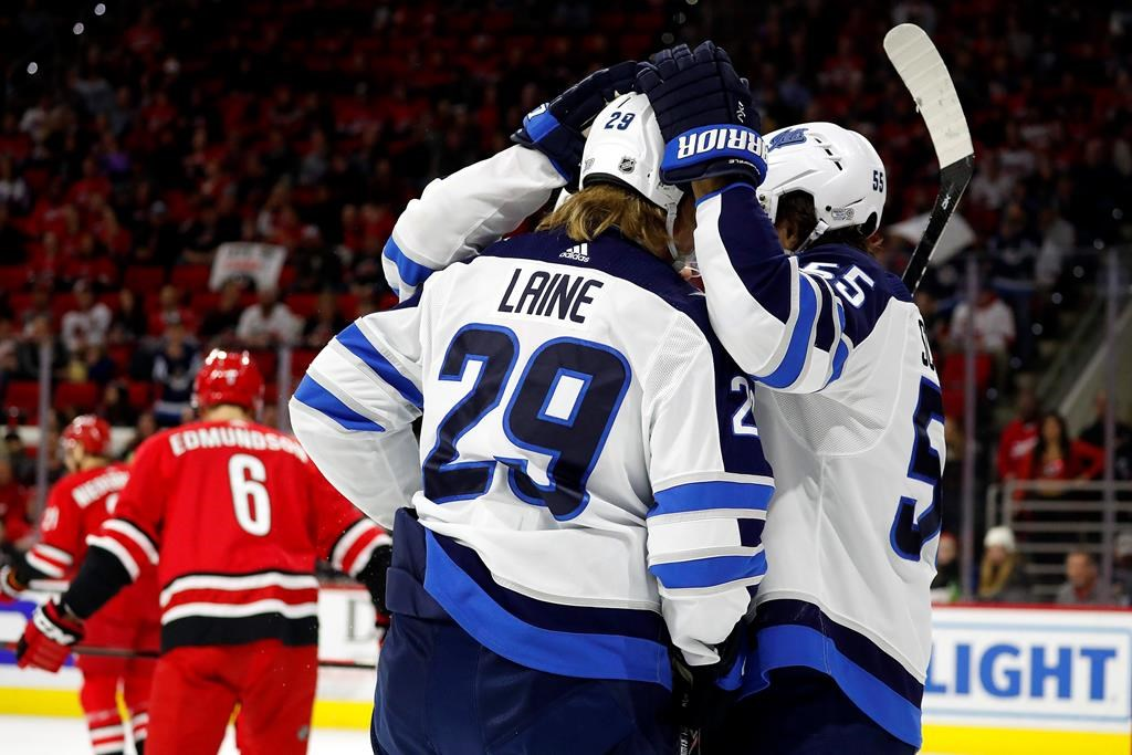 The Winnipeg Jets celebrate a goal by Patrik Laine (29) against the Carolina Hurricanes during the first period of an NHL hockey game in Raleigh, N.C., Tuesday, Jan. 21, 2020. (AP Photo/Karl B DeBlaker).