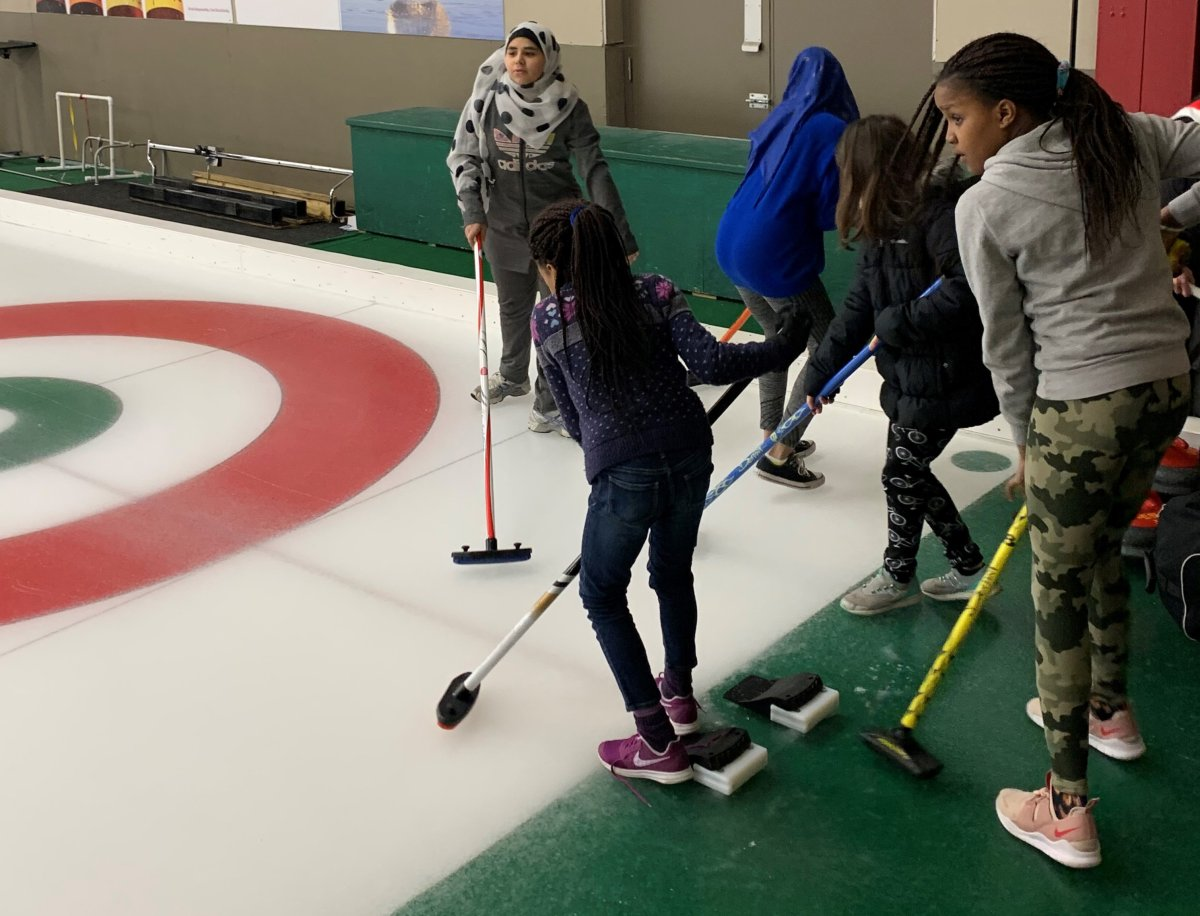 Children take part in a Manitoba program that introduces new Canadians to curling at the Granite Curling Club in Winnipeg on Jan. 4, 2020 in a handout photo.