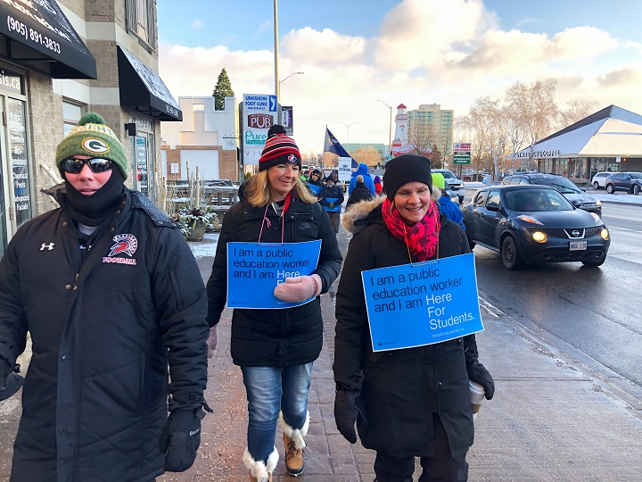 Ontario's high school teachers and educational workers from eight school boards on strike for one day. Picketers strike in Mississauga.