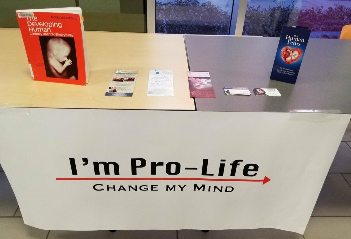 An image of an informational booth run by the UAlberta Pro-Life group. The group has won a challenge against a security fee implemented against it by the University of Alberta.