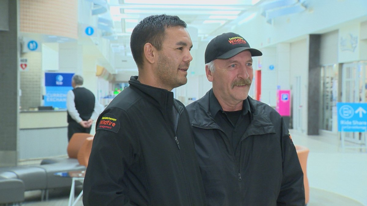Ile-a-la-Crosse's Phane Ray (left) and Creighton's Kevin Buettner (right) return home from Australia after 38 days of assisting crews battling bushfires.