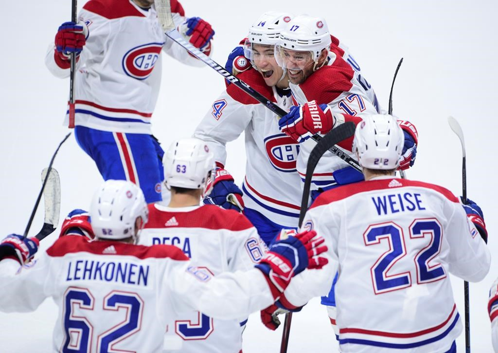 Montreal Canadiens' Ilya Kovalchuk celebrate a win with his teammates in this file photo.   their 2-1 win over the Ottawa Senators following NHL action in Ottawa on Saturday, Jan. 11, 2020. THE CANADIAN PRESS/Sean Kilpatrick.