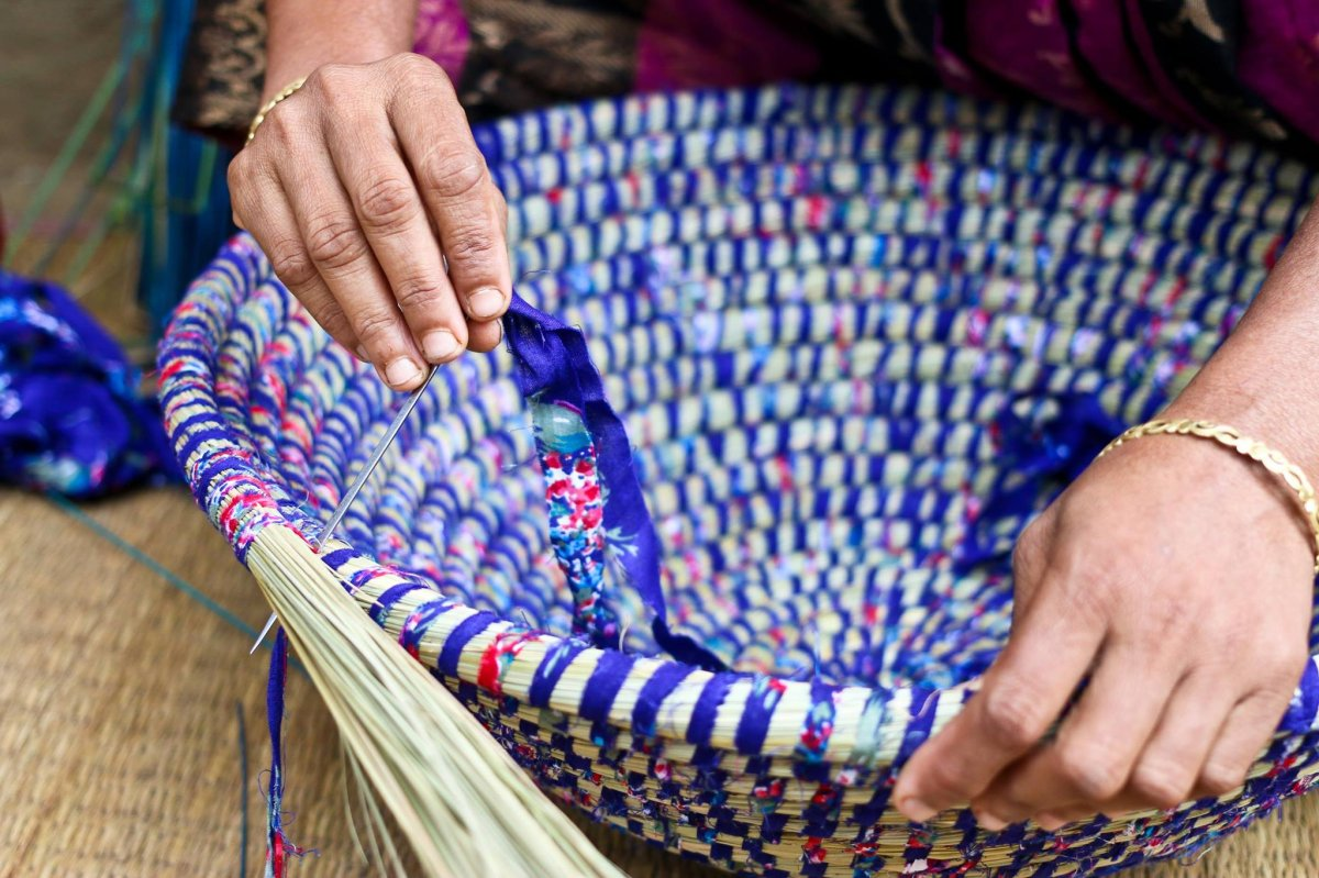 Image shows woven bowl for sale at Canadian Ten Thousand Village store.