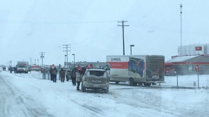 Locked-out Unifor workers block access to the Prairie Sky Co-op's Crossroads location in Weyburn.