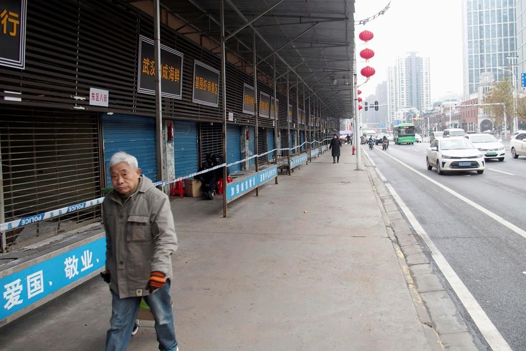 This Jan. 17, 2020, photo, shows the closed Huanan Seafood Wholesale Market in Wuhan, China. (Kyodo News via AP).