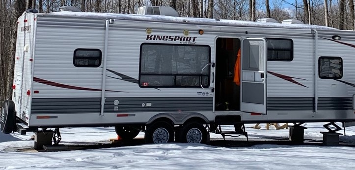 A camping trailer, an ATV and a utility trailer were reported stolen from a hunting camp in Peterborough County .