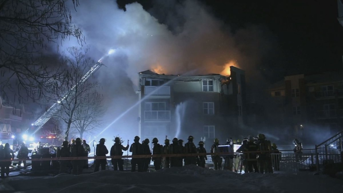 Montreal firefighters battle a four-alarm fire in Pointe-aux-Trembles on Tuesday, Jan. 28, 2020.