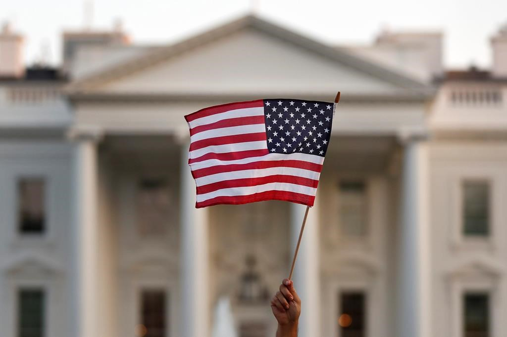 In this Sept. 2017 file photo, a flag is waved during an immigration rally outside the White House, in Washington.