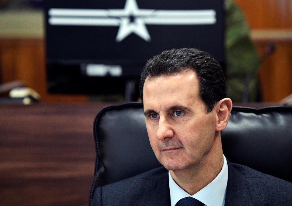 Syrian President Bashar Assad listens to Russian President Vladimir Putin during their meeting in Damascus, Syria, Jan. 7, 2020.