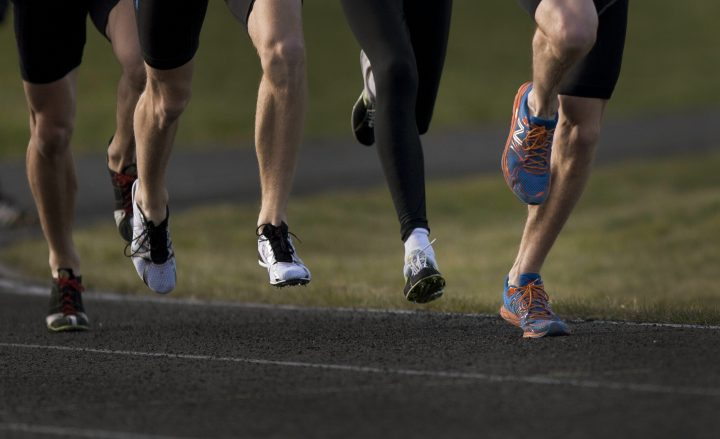 FILE PHOTO: Runners from a program overseen by coach Dave Scott-Thomas at a training session in Guelph Apr. 11, 2012.