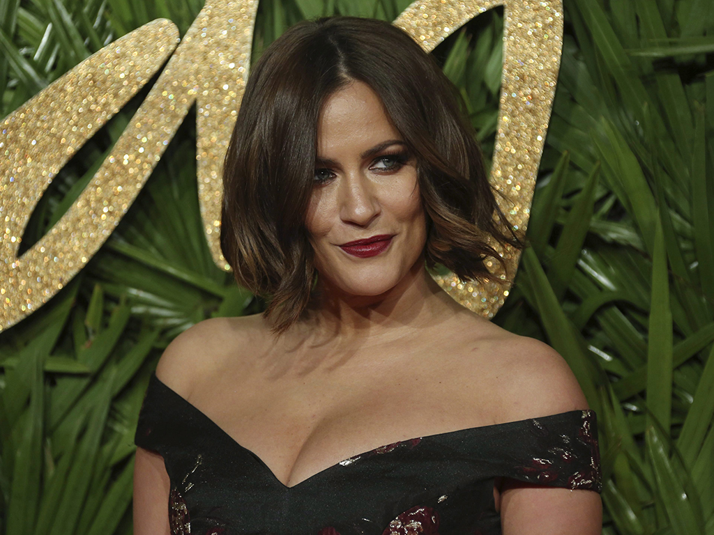Caroline Flack poses upon arrival at The British Fashion Awards 2017 in London, on Monday, Dec. 4, 2017.