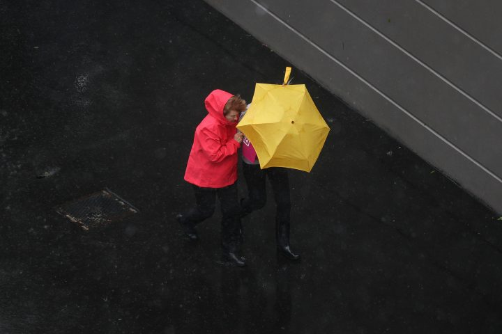 Pedestrians brave strong wind and rain in Sydney, New South Wales, Australia, February 9, 2020.