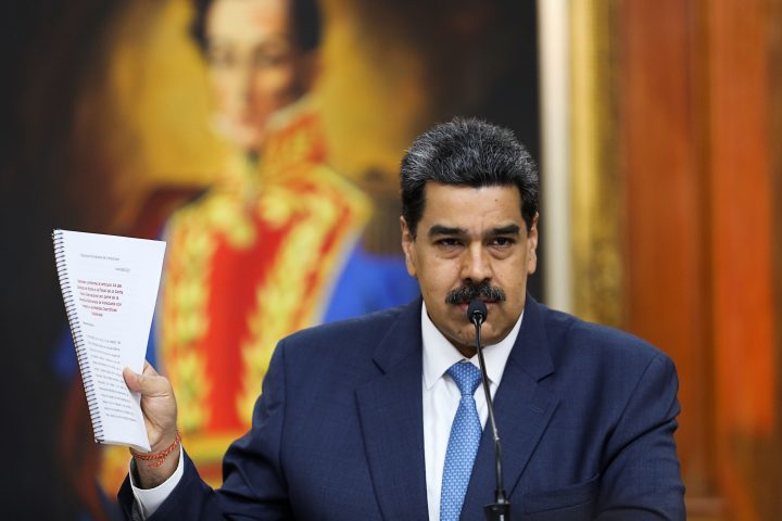 Venezuela's President Nicolas Maduro holds a document as he speaks during a news conference at Miraflores Palace in Caracas, Venezuela.