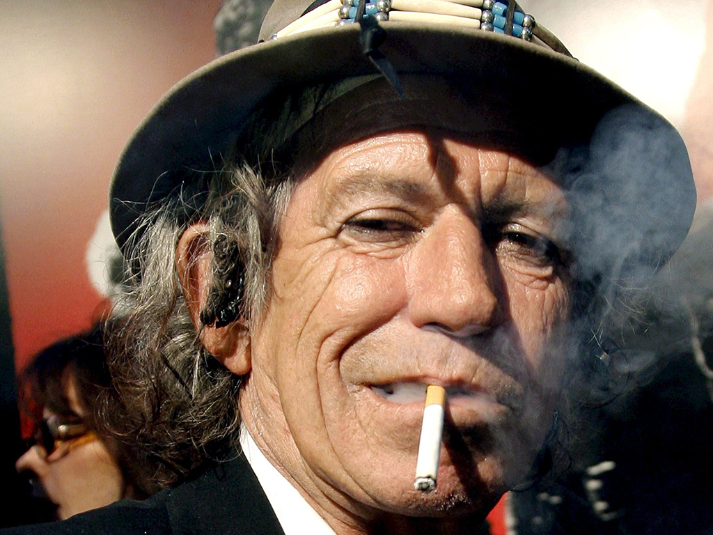 A file picture dated March 30, 2008 shows Rolling Stones guitarist Keith Richards smoking a cigarette at the Ziegfeld Theater in New York City.