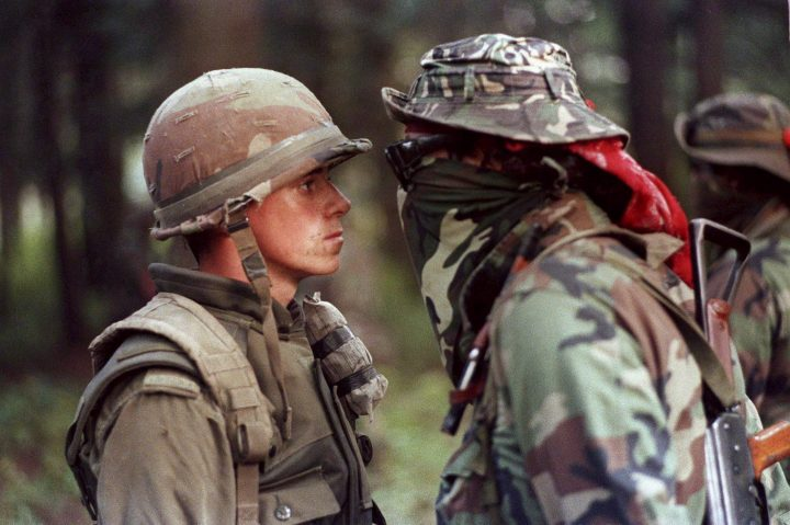 "Canadian soldier Patrick Cloutier and Brad Laroque alias ""Freddy Kruger"" come face to face in a tense standoff at the Kahnesatake reserve in Oka, Que., Sept. 1, 1990."