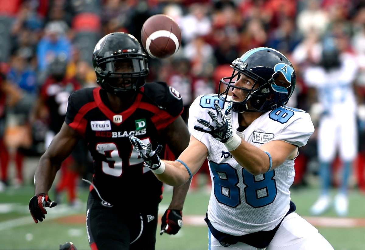 Toronto Argonauts wide receiver Jimmy Ralph (88) makes the catch in front of Ottawa Redblacks defensive back De'Chavon Hayes (34) during first half CFL football action in Ottawa on Saturday, Sept. 7, 2019.