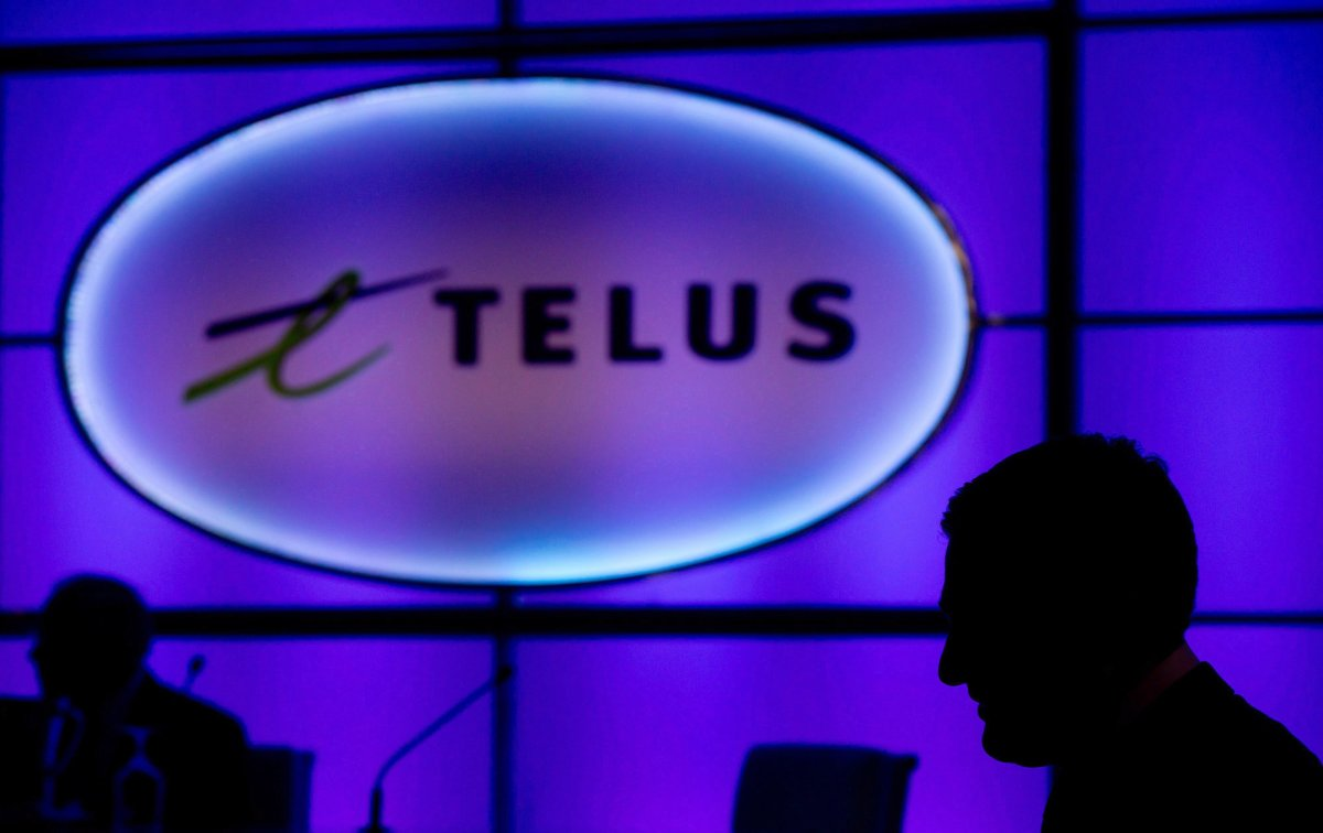 A Telus sign is pictured at company's annual meeting in Vancouver on May 8, 2014.