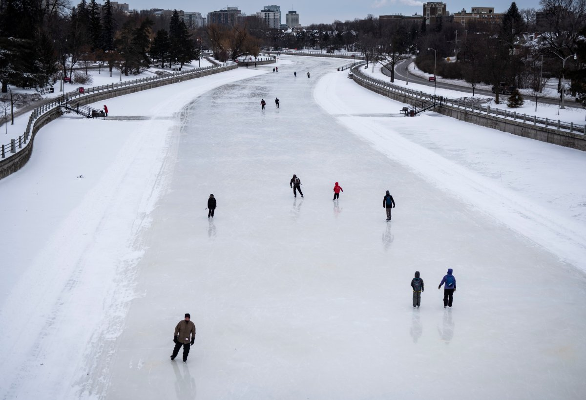 Skaters makes their way along the Rideau Canal Skateway in Ottawa on the opening day of its 50th season, on Saturday, Jan. 18, 2020.
